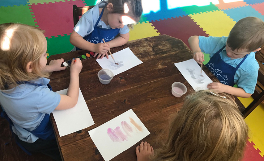 kids painting with water colors